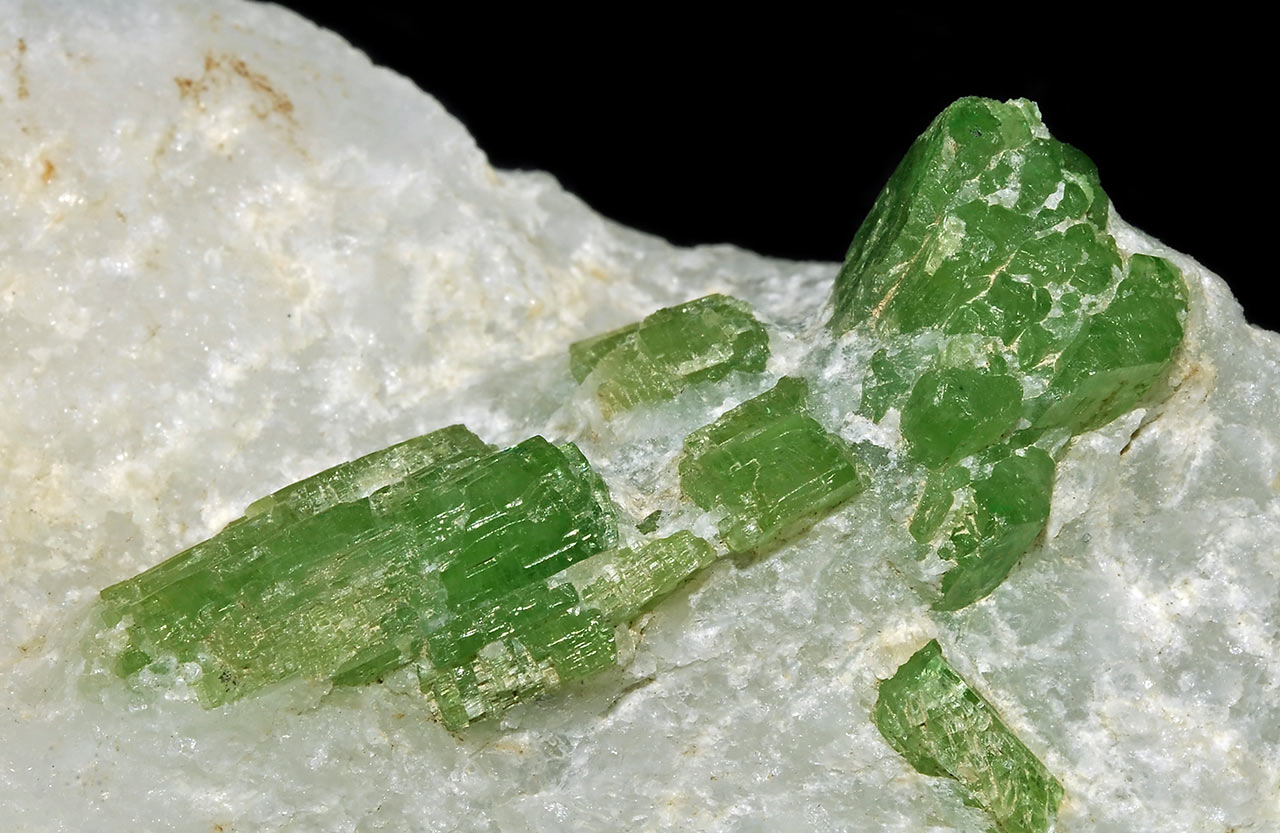 Bright green pargasite crystals in marble from Luc Yen, Yen Bai Province, Vietnam