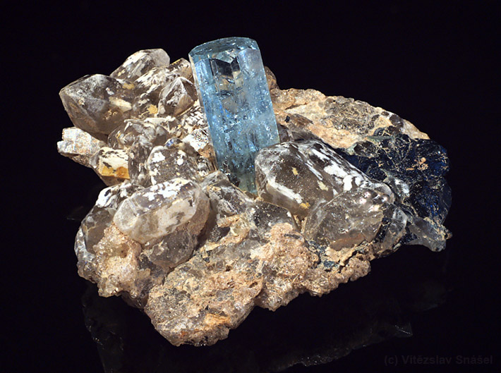 Terminated aquamarine crystal on smoky quartz matrix from Erongo, Namibia