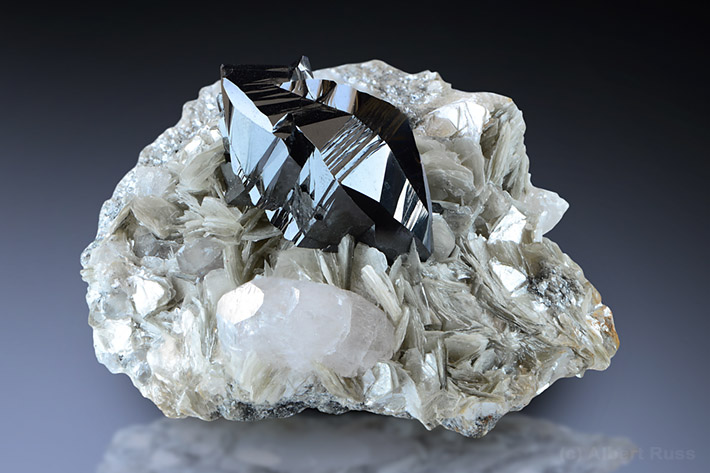Cassiterite and beryl crystals on mica matrix from Pingwu Mine, Sichuan Province, China