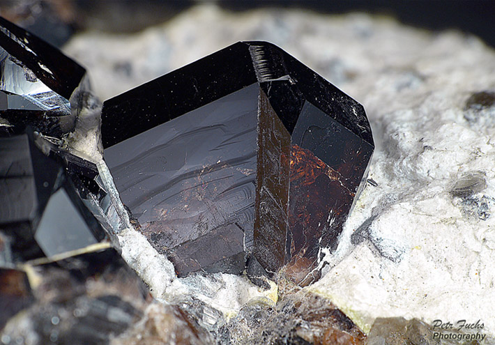 Twinned crystal of cassiterite from Krupka, Czech Republic