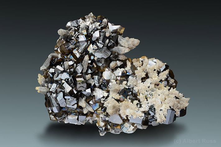 Gemmy cassiterite crystals on quartz matrix from Viloco Mine, Loayza, Bolivia