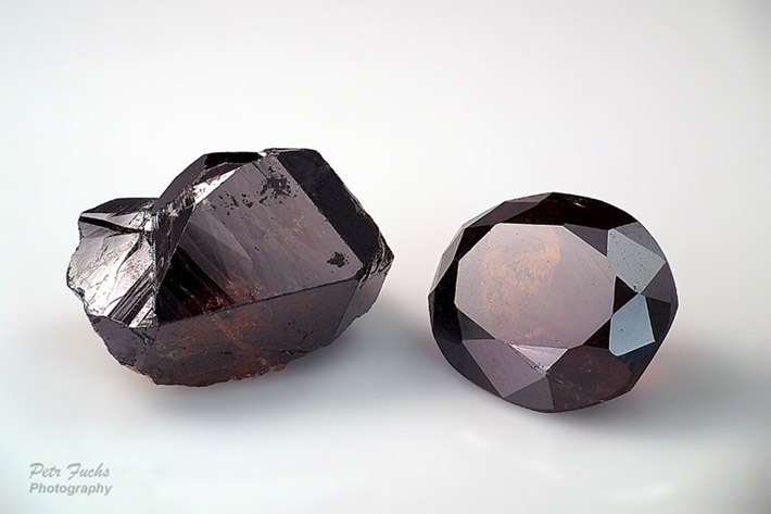 Gemmy cassiterite crystal and faceted cassiterite from Krupka, Czech Republic