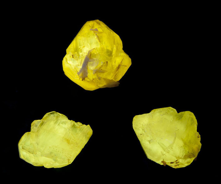 Cerussite crystals from Mibladen, Morocco showing bright yellow fluorescence in shortwave UV light