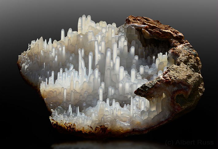 Geode filled with stalactites of chalcedony from Morocco