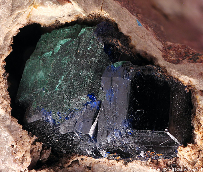 Blue azurite crystals partially pseudomorphed by green malachite from Kerrouchen, Morocco