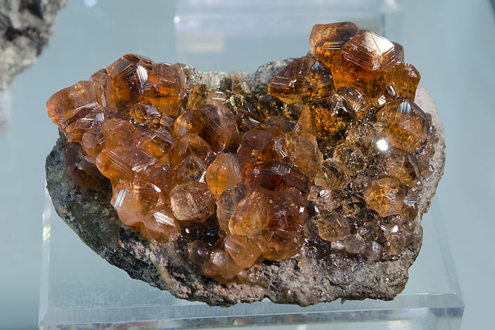 Hessonite crystals from Jeffrey Mine, Canada