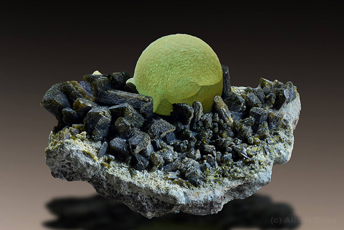 Prehnite ball sitiing on the cluster of epidote crystals from Kayes region in Mali