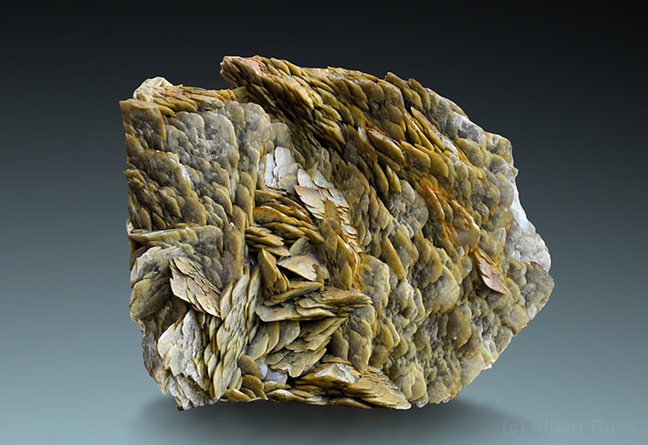 Cluster of typical pale brown flat and curved siderite crystals from Rudnany, Slovakia