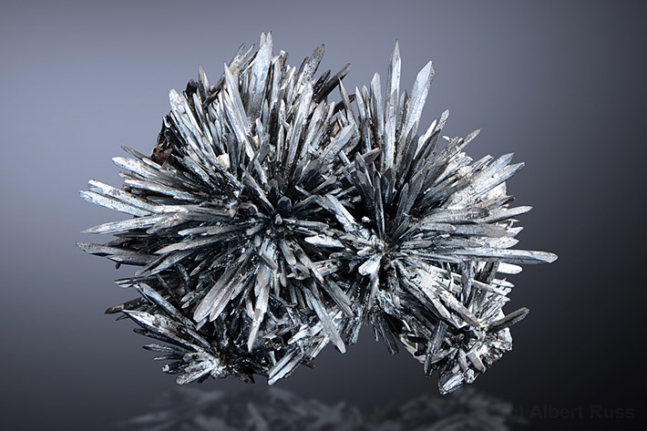 Cluster of needle-shaped stibnite crystals from Romania