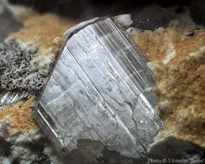 Macrophoto of the small clear topaz crystal from Krupka in Czech Republic